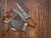 Vintage kitchen knives  collage over old wood — Stock Photo