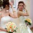 The bride looks in the mirror — Stock Photo #11870385