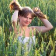 Beautiful girl In a wheat field — Stock Photo #12344314
