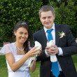Portrait of bride and groom in the hands of the pigeons — Stock Photo