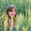 Beautiful girl In a wheat field — Stock Photo