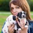 Young Women Holding Two Puppies — Stock Photo