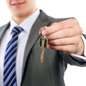 Young realtor handing keys — Stock Photo