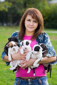 Young Women Holding Five Small Puppies — Stock Photo