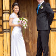 The bride and groom on a wooden porch — Stock Photo