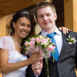 Stock Photo: The bride and groom with a bouquet