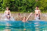 Happy children in a swimming pool  — Stock Photo