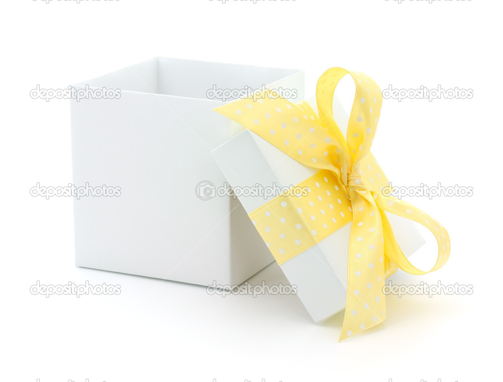 Open empty gift box and yellow bow. Isolated.  Stock Photo #15681189
