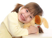 Smiling baby playing with toy — Stock Photo