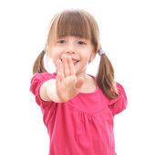 Smiling little girl showing her hand up — Stock Photo