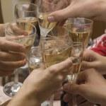 Celebration. Hands holding the glasses o — Stock Photo #1178621