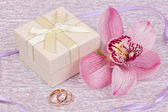 Box for gift and orchid — Stock Photo
