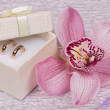 Wedding rings and orhid flower - Stock Photo