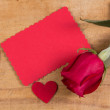 Stock Photo: Red rose and card