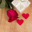 Stock Photo: Red rose and gift