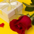 Gift and red rose - Stock Photo