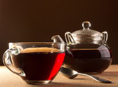 Cup with tea and teapot — Stock Photo