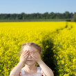 Little girl on yellow field — Stock Photo #19110451
