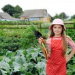 Stock Photo: Girl working in garden