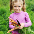 Girl with carrot — Stock Photo