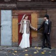 Bride and a groom standing near the building — Stock Photo #36584781