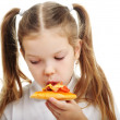 Little girl eating pizza — Stock Photo #36586029
