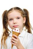 Joyful child girl eats ice-cream. — Stock Photo