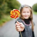 Girl with lollipop — Stock Photo #8660071
