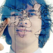 Young businessman with map of the world — Stock Photo #8663108