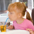 Royalty-Free Stock Photo: Children drinking fruit juice in cafe