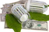 Luminescent lamps on a background from dollars — Stock Photo