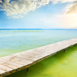 Stock Photo: Wooden pier on beautiful lake.