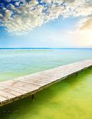 Wooden pier on beautiful lake. — Stock Photo