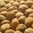 Closeup of walnuts background. — Stock Photo