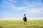 Man on green meadow. — Stock Photo