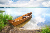 Boat on the bank of lake — Stock Photo