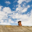 Roof of the house with a brick pipe — Stock Photo
