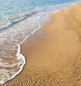 Sand beach and wave — Stock Photo