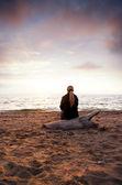 Female silhouette on seacoast — Stock Photo