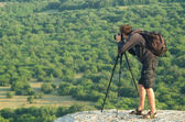 Photographer in mountain — Stock Photo