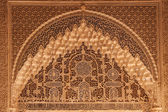 Ancient arabian ornament on a wall in Alhambra palace — Zdjęcie stockowe