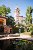 Belltower of St. Mary Church in Generalife gardens  — Stock Photo