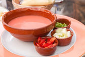 Gaspacho - cold tomato soup with ingredients — Stock Photo