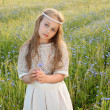 Sweet and pacified girl in a long dress are risen ear - Stock Photo