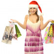 Beautiful girl shows a lot of beautiful paper bags — Stock Photo #17651067
