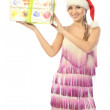 Royalty-Free Stock Photo: Beautiful girl shows a wrapped gift