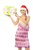 Beautiful girl shows a wrapped gift — Stock Photo
