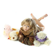Little girl with plush toys — Stock Photo