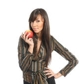 Beautiful brunette businesswoman holding an apple — Stock Photo