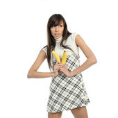 Young woman in dress with bananas — Stock Photo
